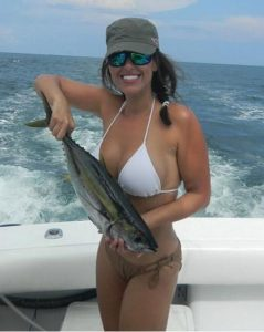 girl with yellowfin tuna